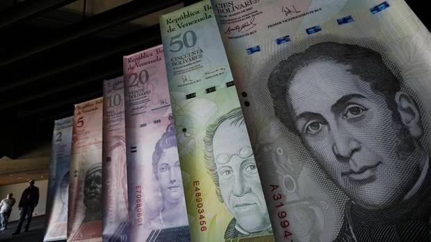 Samples of Venezuela's currencies are displayed at the Central Bank building in Caracas February 10, 2015.