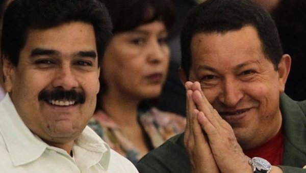 Venezuela's President Hugo Chavez (R) gestures next to Nicolas Maduro. Both Venezuelan president have been targets of dishonest and hostile reporting by Western media outlets. (Reuters)