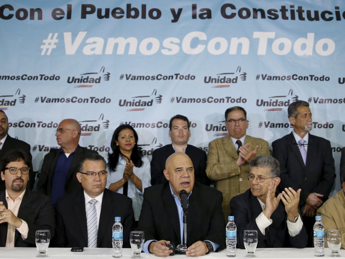 "Caption: MUD press conference announcing their ""roadmap for change"". (Carlos Garcia Rawlins/Reuters)"