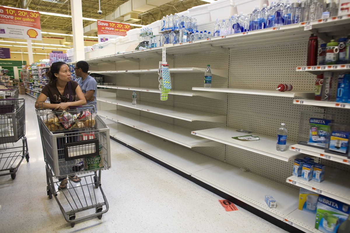 "The original high resolution photo. Original caption: ""A shopper passes empty shelves while looking for bottled water at a Stop and Shop at Rockaway Beach in New York, August 26, 2011. As North Carolina braced on Friday for a direct hit from Hurricane Irene, cities along the East Coast were on alert and millions of beach goers cut short vacations to escape the powerful storm. With more than 50 million people potentially in Irene's path, residents stocked up on food and water and worked to secure homes, vehicles and boats. States, cities, ports, oil refineries and nuclear plants scrambled to activate emergency plans.""