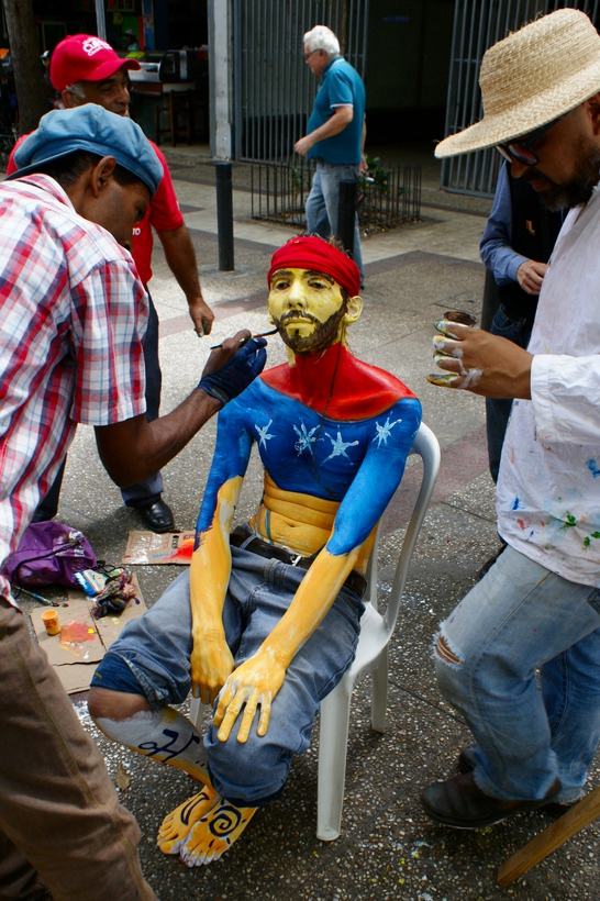 """""""We are depicting Reverón through body paint. He was thin, bronzed by the sun, he always carried a belt of paintbrushes with him. That's how he walked through the streets"""". (Jonas Holldack/Venezuelanalysis)"""