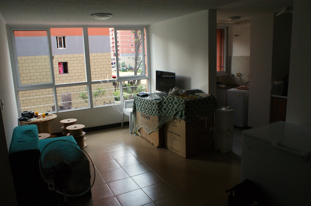 "There are two, three and four bedroom apartments with one or two bathrooms. ""I belong to a collective and we turned in a request to all the ministries. Each month, one of us went to the ministries to deliver our proposal so they would issue us housing. Now, nearly all of us live here,"" Ángel explains. (Jonas Holldack/Venezuelanalysis)"