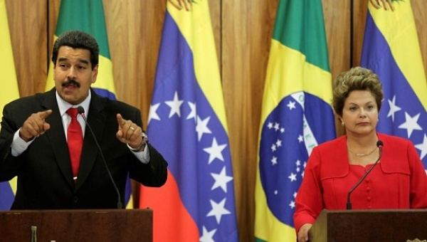 Venezuela's President Nicolas Maduro (L) delivers a statement to the media with Brazil's President Dilma Rousseff at the Planalto Palace in Brasilia. (Reuters)