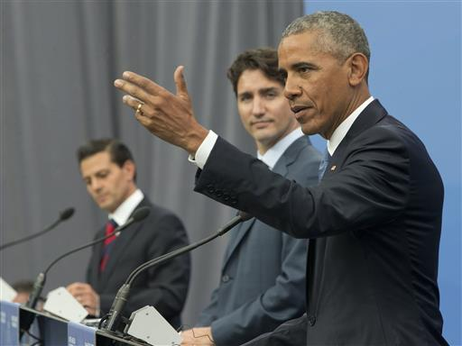US President Barack Obama speaks alongside his Mexican and Canadian counterparts from the North American Leaders Congress on Canada (Associated Press).