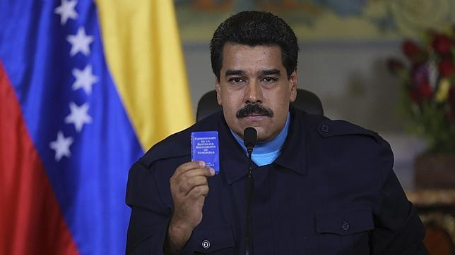President Maduro with copy of Venezuelan constitution. (Reuters)