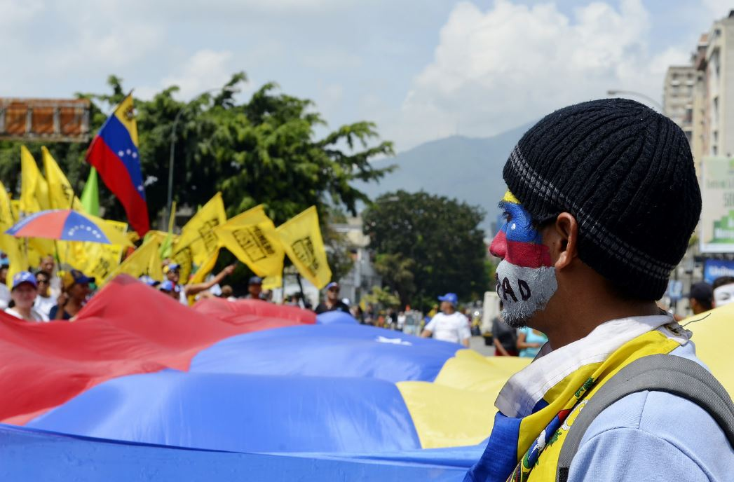 An opposition protest in Caracas, Venezuela in 2014 (Carlos Díaz/Flickr).