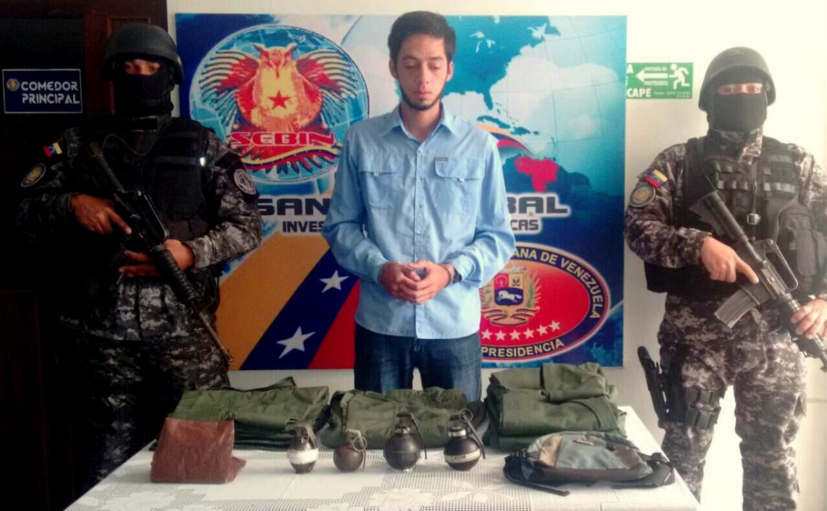 Opposition City Councilman Jose Vicente Garcia with confiscated grenades and military vests (Twitter/@VielmaEsTachira)