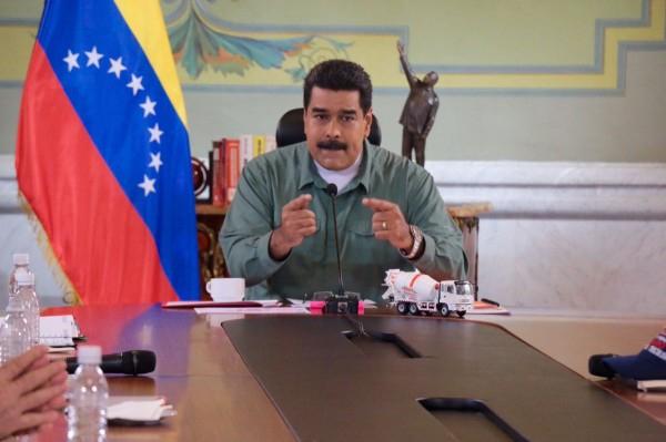 Venezuela's President Nicolas Maduro has accused international financial agencies of trying to destabilise his government. (@DPresidencia)
