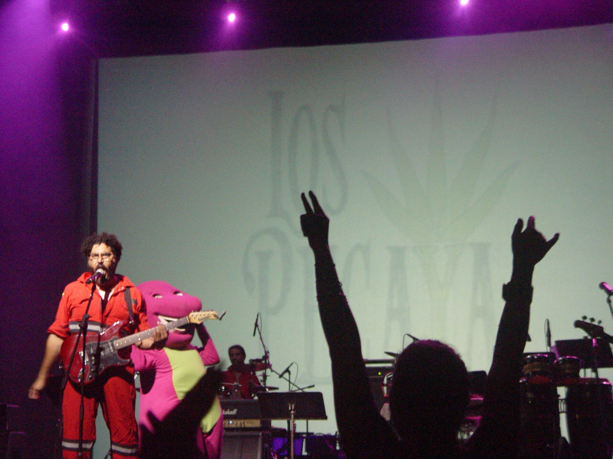 """Los Pecaya, an alternative rock band based in Caracas, performed a humorous piece on the popular US children's character """"Barney"""", the dinosaur. (Venezuelanalysis/Paola Martucci Gómez)"""