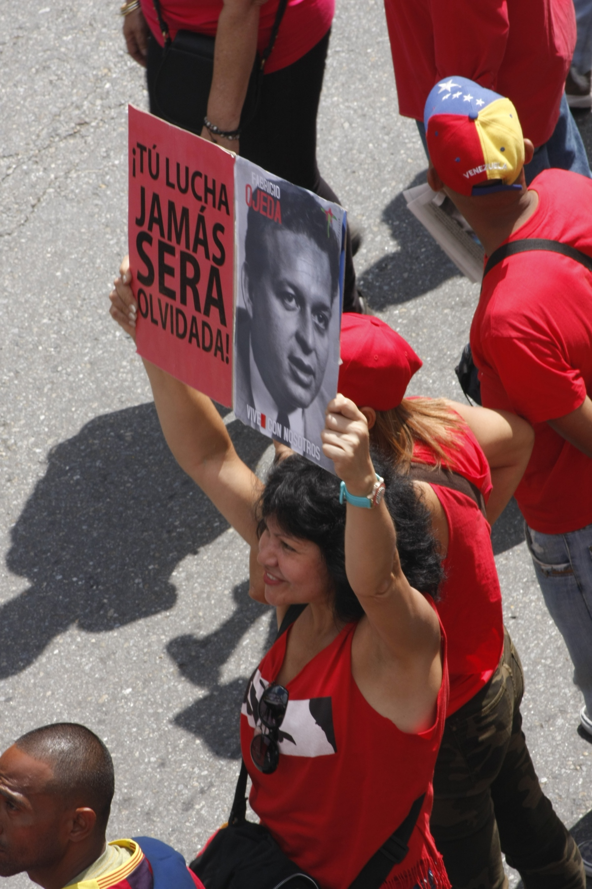 "Sign reads ""Your struggle will never be forgotten"" and features an image of a young Fabricio Ojeda. (Paola Martucci Gómez - Venezuelanalysis.com)"
