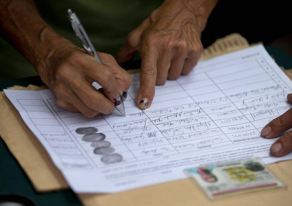 A petition backing a referendum against President Nicolas Maduro. ( Fernando Llano/AP)