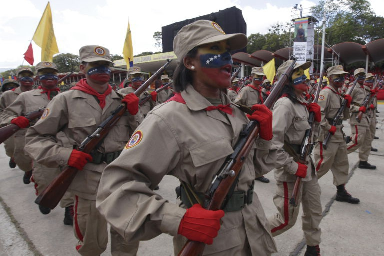 Members of the Bolivarian militia celebrate Zamora.