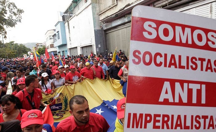 """We are socialists, anti-imperialists"" reads one sign at Tuesday's protest. (AVN)"