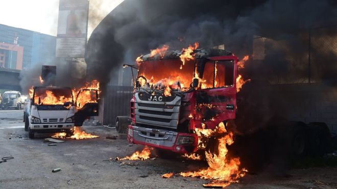 Venezuelan Transport Ministry vehicles set on fire by opposition demonstrators. (AFP)
