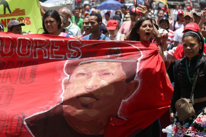 Venezuelans carried their banners reflecting their commitment to the Bolivarian process and Hugo Chávez's legacy. (Gregorio Teran)
