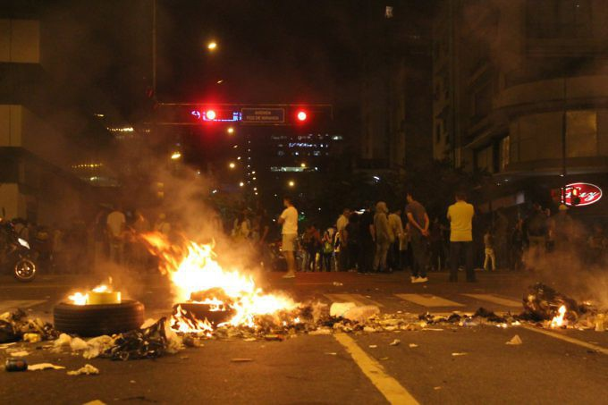 Opposition supporters continued their protests well into the evening on Saturday, burning tires and other materials on Francisco Miranda Avenue in eastern Caracas. (Horacio Siciliano)