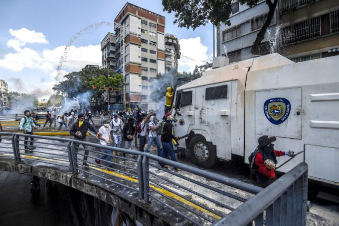 Opposition supporters engaged in violent protest against the Bolivarian government and clashed with authorities. (AFP)