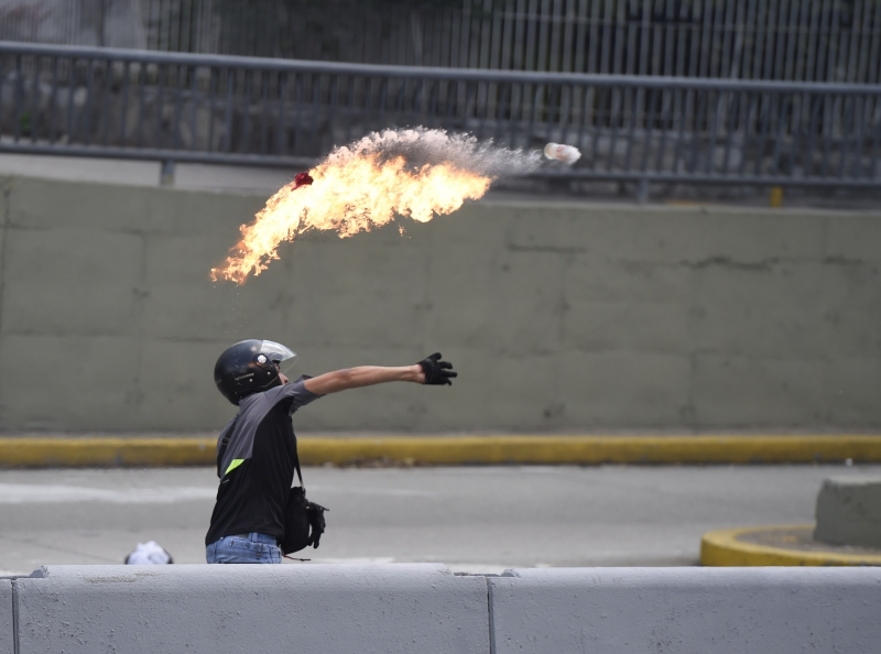 Opposition protesters have repeatedly used molotovs and other makeshift explosive devices against authorities and government buildings. (AFP)