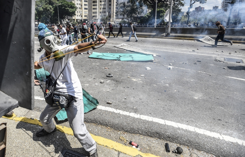 Anti-government demonstrators clash with authorities on Liberator Avenue in central Caracas. (AFP)