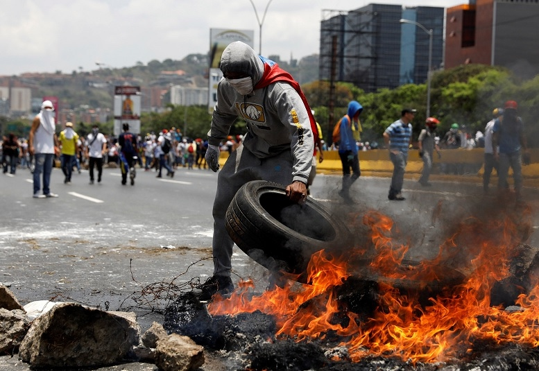 An anti-government protester in Caracas, Venezuela. (Reuters)