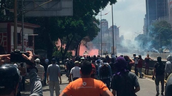 Red smoke seen at a distance during opposition protest in Caracas on Saturday. (LaPatilla)