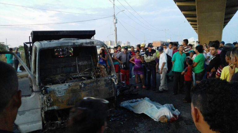 A motorcyclist was reportedly burned alive by protesters after he was run over by a truck at a barricade in Maracaibo. (@JorgeGalindo)