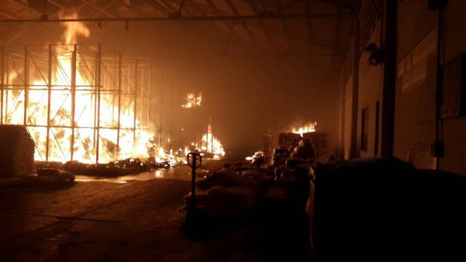 Around half the food in a government distribution centre was torched Thursday. (AVN)