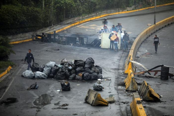 Venezuelan opposition groups have been accused of endangering civilians with barricades covering roads. (Reuters/ Carlos Barria)