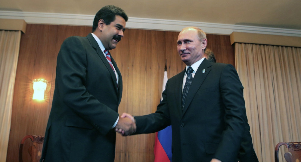 Venezuelan President Nicolas Maduro and his Russian counterpart Vladimir Putin shake hands in this 2015 photo. (AFP)