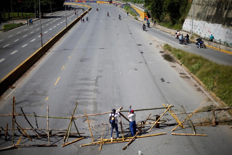 An opposition barricade blocks a Caracas highway on Friday morning. (Reuters)
