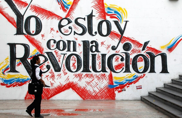 "Mural reads ""I'm with the revolution!"". (Abyayala)"