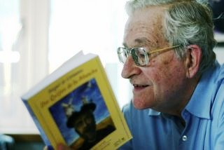 Prof. Noam Chomsky leafs through the book Don Quijote, which the Chavez government distributed for free to Venezuelans (Credit: Juan Carlos Yegres)