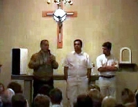 Opposition leaders Alejandro Peña Esclusa and Leopoldo Lopez speaking at a church in Caracas (YouTube)