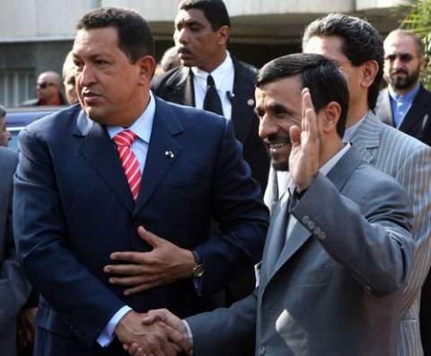 Iranian President Mahmoud Ahmadinejad receives Venezuelan President Hugo Chavez upon his arrival to Tehran on Monday. (Reuters)
