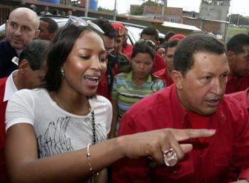 Supermodel Naomi Campbell and Venezuelan President Hugo Chavez tour a new housing complex in Caracas (AP Photo/Howard Yanes)
