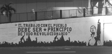 "A political mural in Caracas that reads "" Work amongst the people must be the first principle of any revolutionary""."