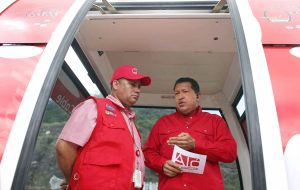 Venezuelan President Hugo Chavez stands inside one of the MetroCable cars during his talk show on Sunday. (Prensa Presidencial)