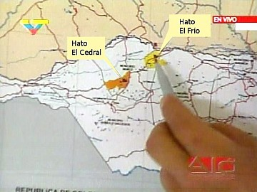 President Chavez points out the location of the two estates that will become socialist production centers.