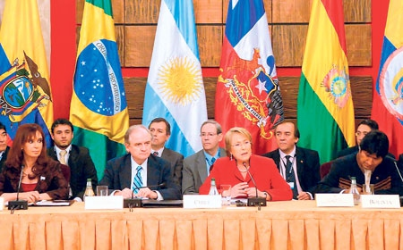 Temporary president of UNASUR, Chilean President Michelle Bachelet (second from right) sitting next to Bolivian President Evo Morales (first from right).