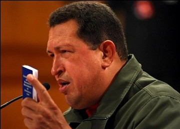 President Chavez holds up a copy of the national constitution of Venezuela during his post-election press conference. (PP)