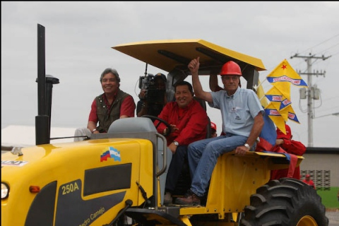 "President Chavez on a tractor in the Agro-industrial complex ""Vuelvan Caras"" (Prensa Presidencial)"