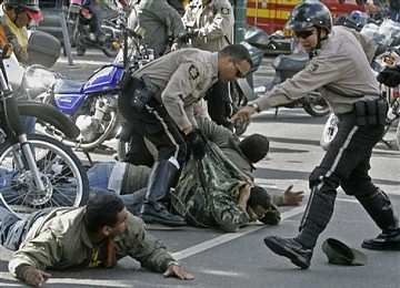 Caracas police detain six pro-Chavez demonstrators who tear gassed an opposition political meeting. (AP)