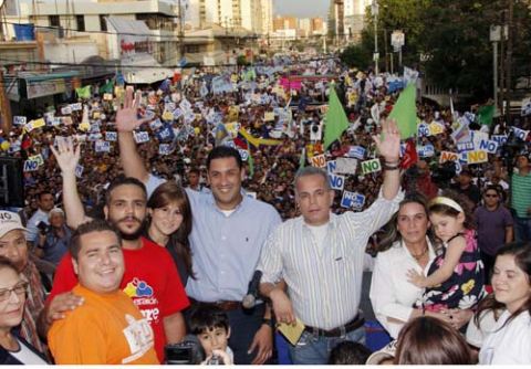 Opposition leader Manuel Rosales (in striped shirt) at a rally against the amendment in Zulia state.