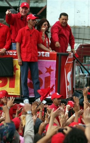 """President Chavez drives through the crowd at the """"Yes"""" rally on Thursday. (AFP)"""