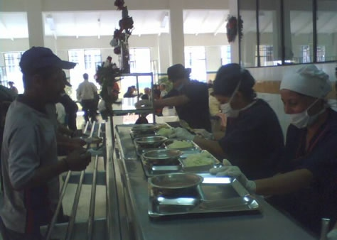 Serving lunch at the comedor.