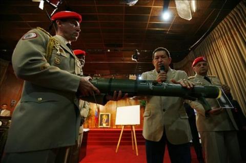 President Chavez talks to international reporters on Wednesday (EFE)