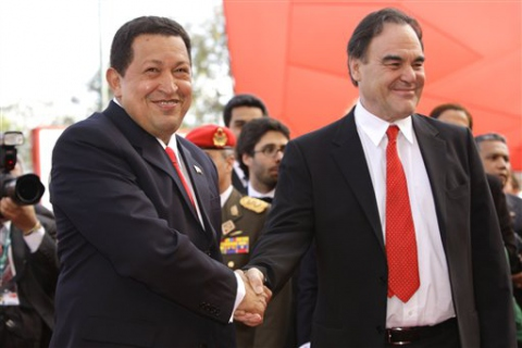 Venezuelan President Hugo Chavez (left) shakes hands with director Oliver Stone (VTV)