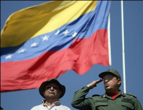 President Hugo Chavez (right) and Vice President Ramon Carrizalez on Monday (YVKE)