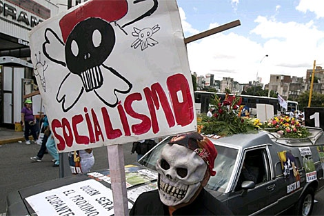 "An opposition placard: ""Socialism"" below a skull and crossbones (Reuters)"
