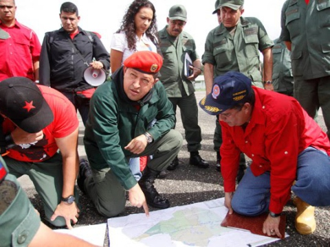 Venezuelan President Hugo Chávez (center), who requested a 12-month Enabling Law that would grant him decreeing powers to address urgent matters such as housing, public works, and finances, has for over a month been on a non-stop, nation-wide, night and day tour of the areas affected by record-setting rains and floods (Agencies)